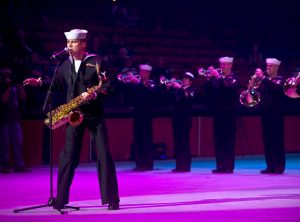 A US Armed Forces member plays saxophone at the International Military Tattoo