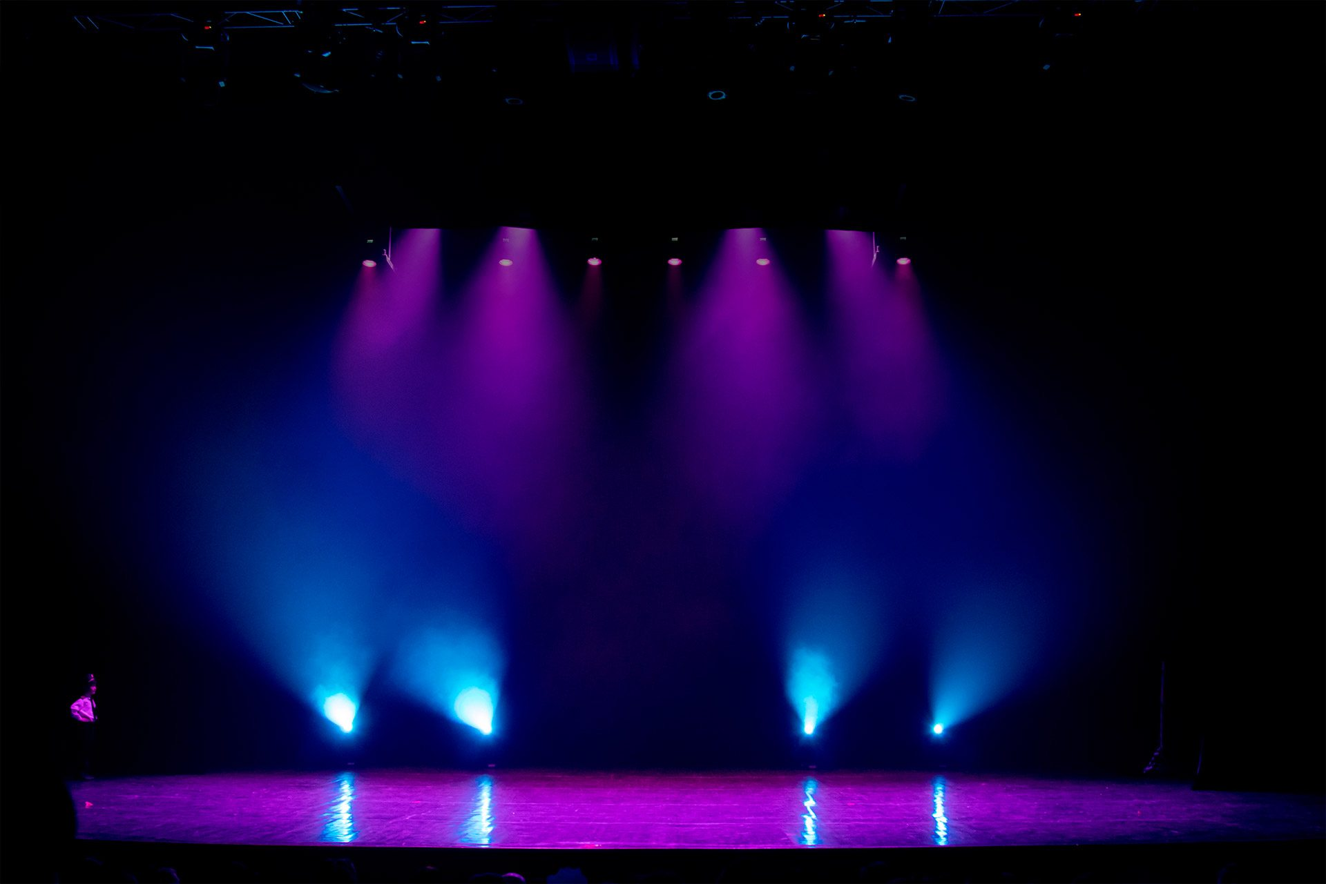stage lighting on an empty stage in a dark room
