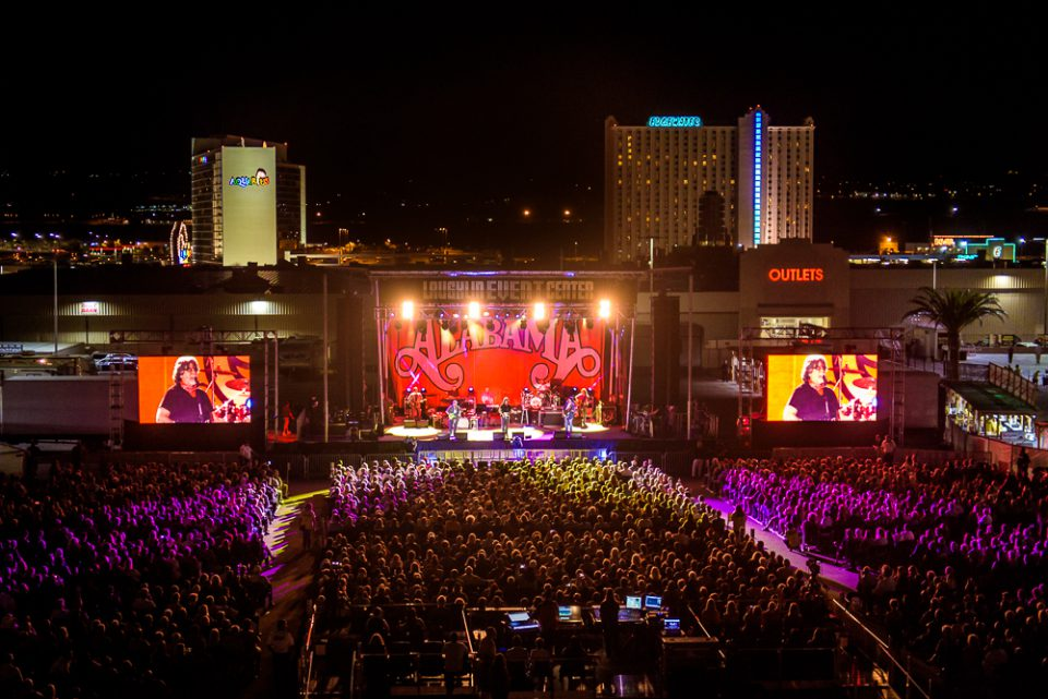 Wide shot of the band Alabama, playing at the Laughlin Event Center
