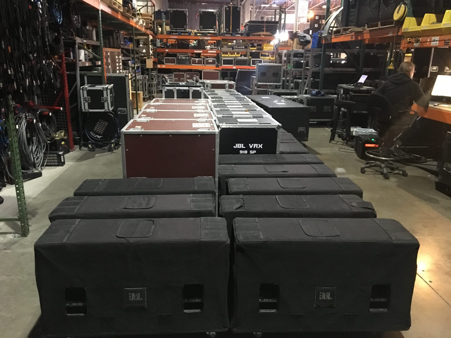 a bunch of JBL Loudspeakers and Amp Racks are waiting to go out on a show