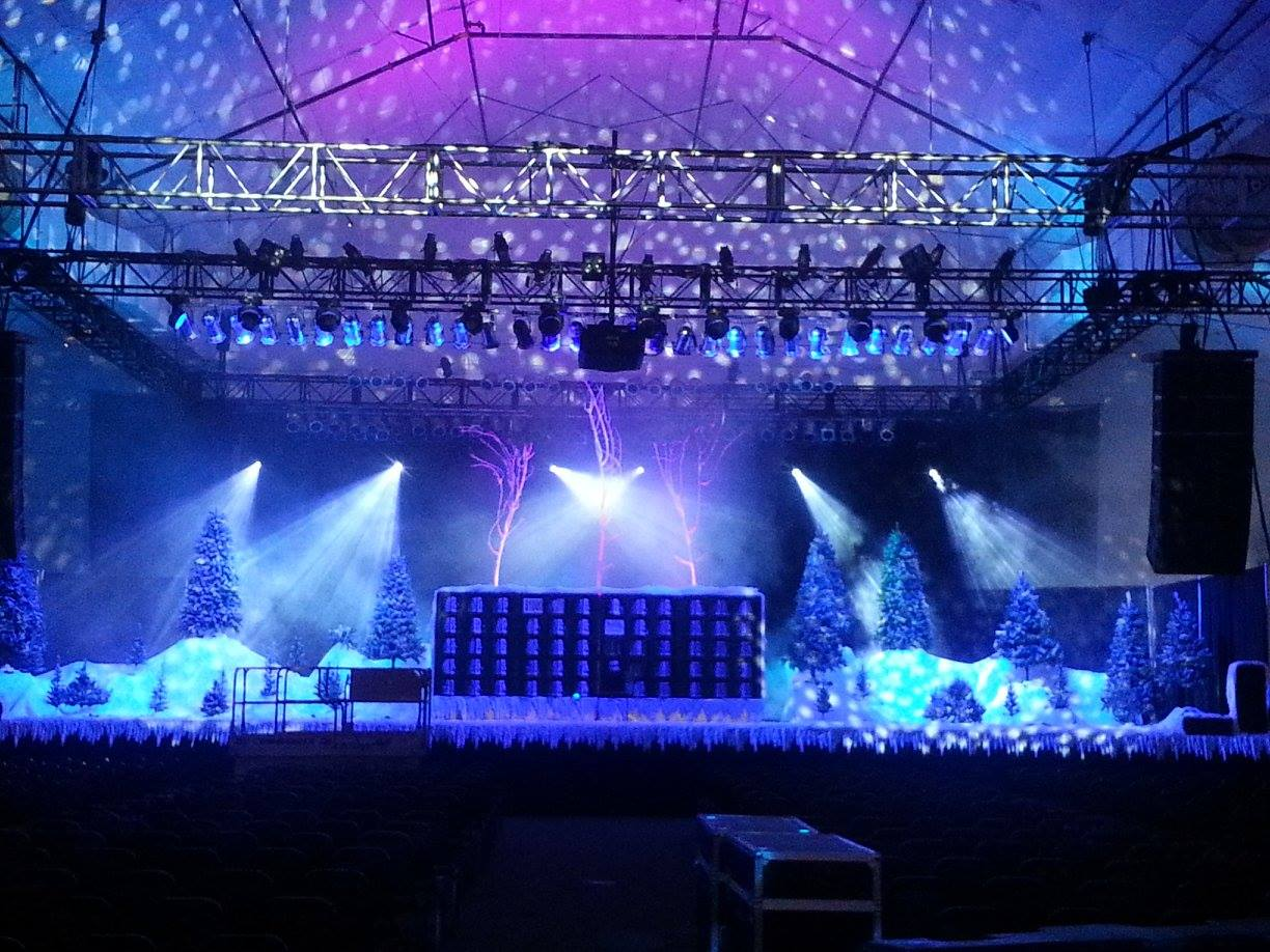 stage lit with blue LED moving lights