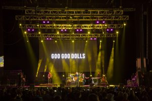 yellow lighting on stage as Goo Goo Dolls plays