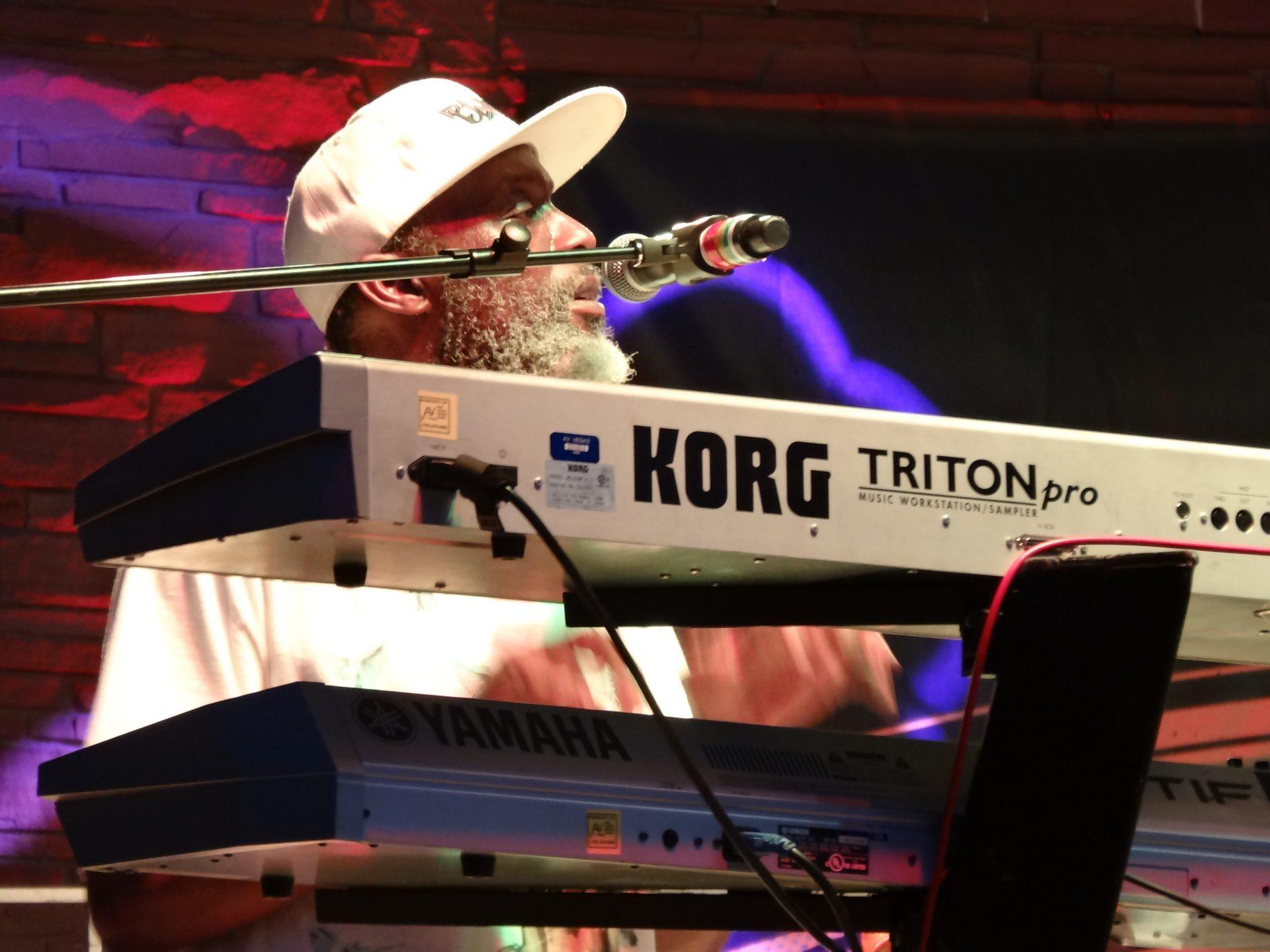 Musician singing and playing keyboard