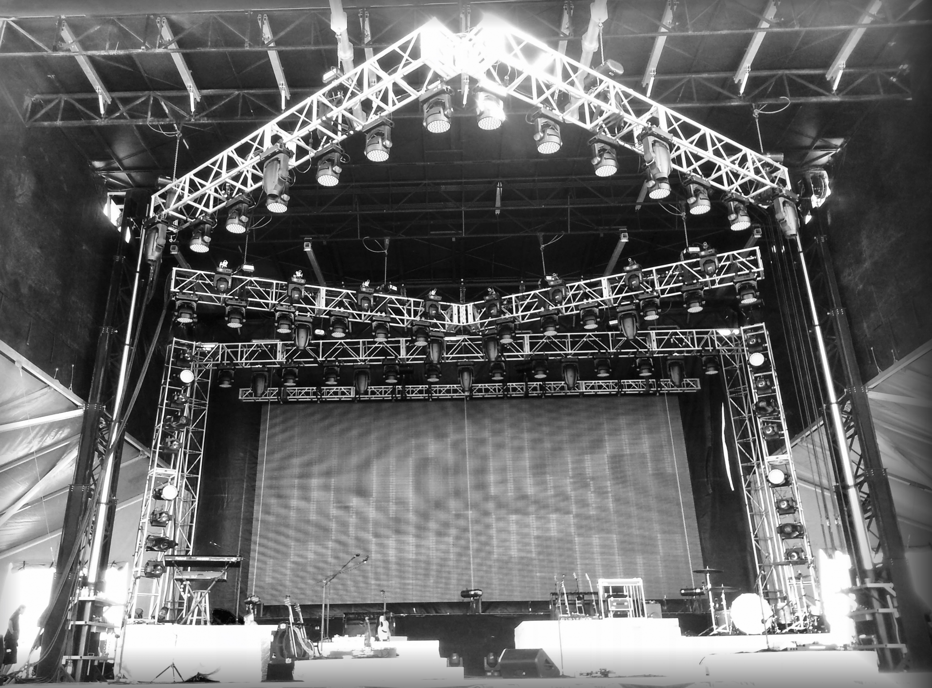 front view of stage shown in black&white, with massive truss structure holding dozens of LED moving lights for Carrie Underwood concert