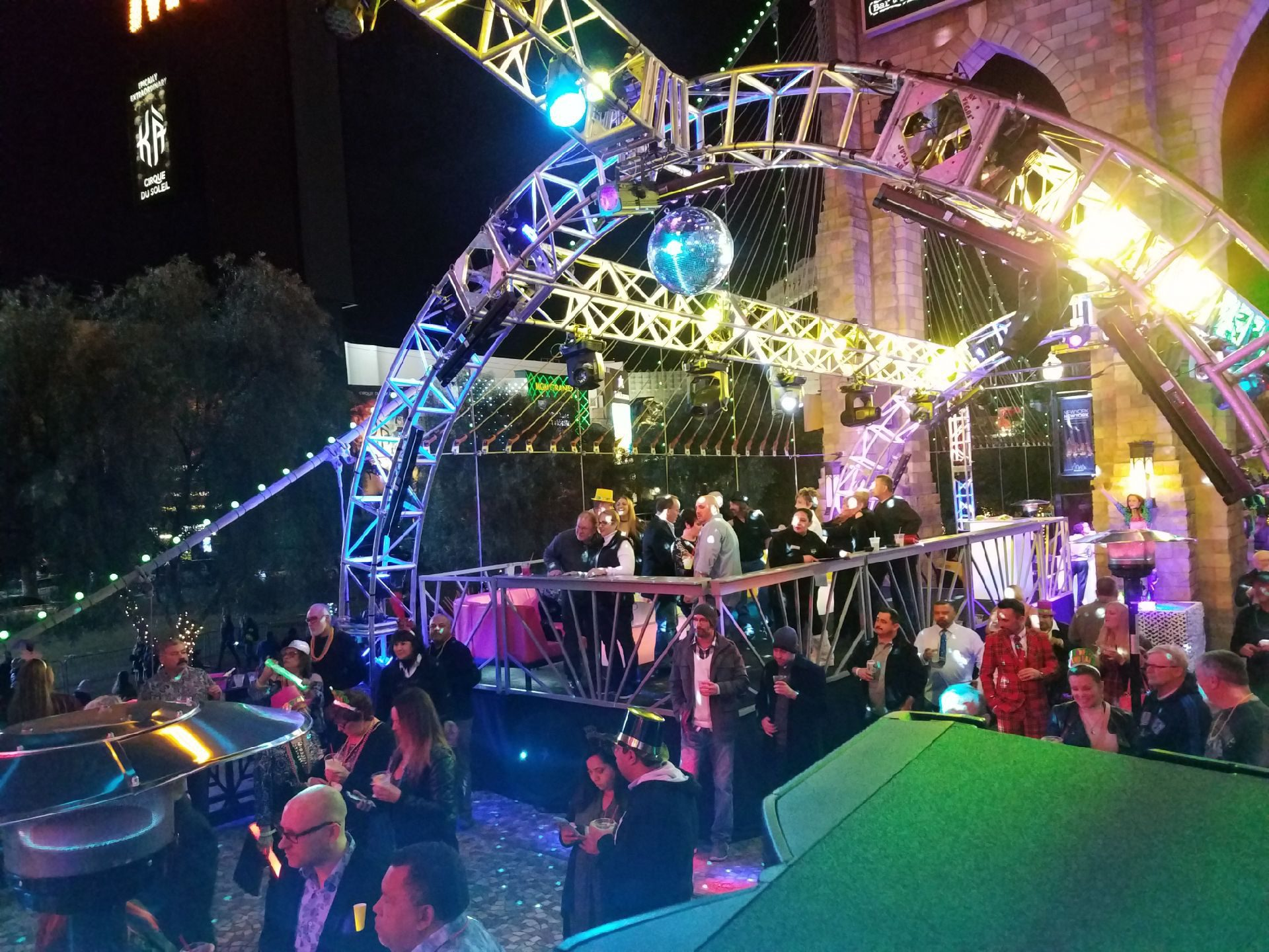 Wide view of New York, New York's New years eve party, including lighted truss system and party guests
