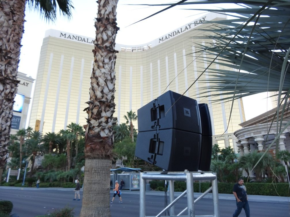 JBL speakers mounted atop a stick of truss and installed in front of Mandalay Bay hotel.